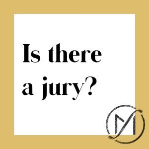 white square with a gold border and the words is there a jury written in black with the freed marcroft logo in the lower right corner