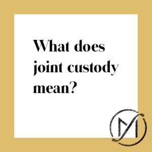 "Gold border around a white square that says ""What does joint custody mean?"" in black letters."