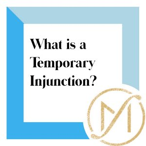 """Blue border with """"What is a Temporary Injunction?"""" in black lettering and the gold Freed Marcroft LLC divorce and family law attorneys logo in the lower right corner."""